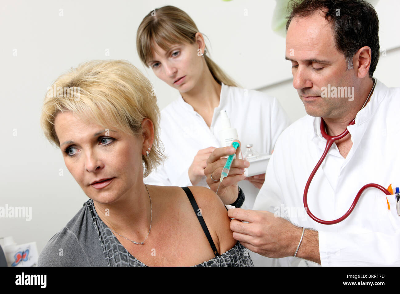 Medical practice, Immunization injection. Female patient. - Stock Image