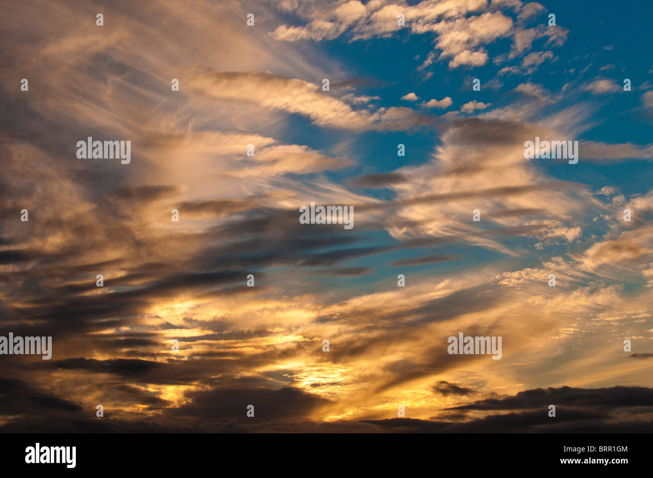Cirrus clouds at sunset - Stock Image