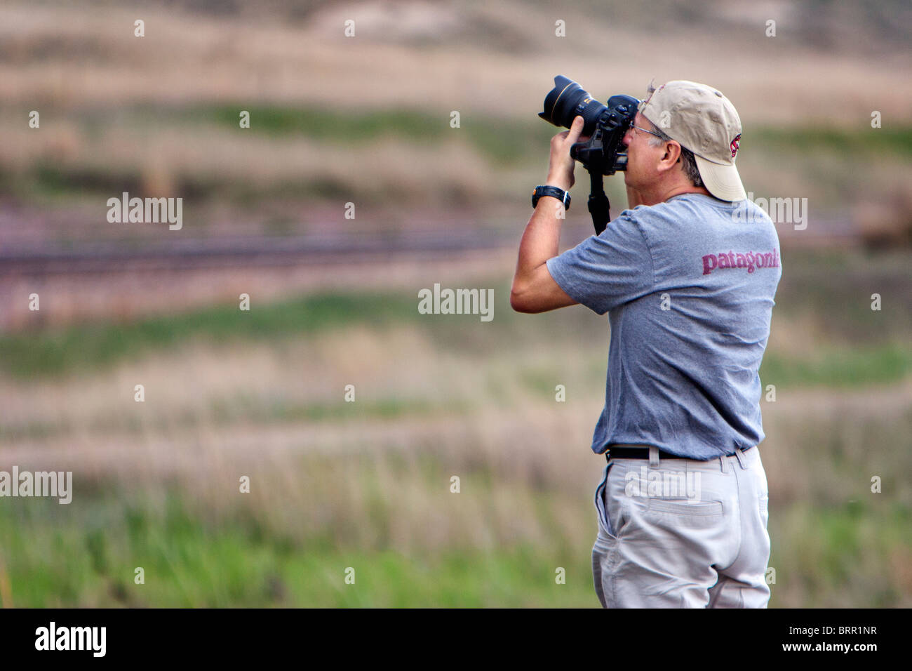 Professional photographer Jim Reed takes a photo, May 29, 2010. - Stock Image