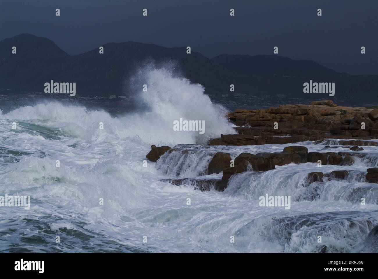 A storm at sea with waves crashing on the shore - Stock Image