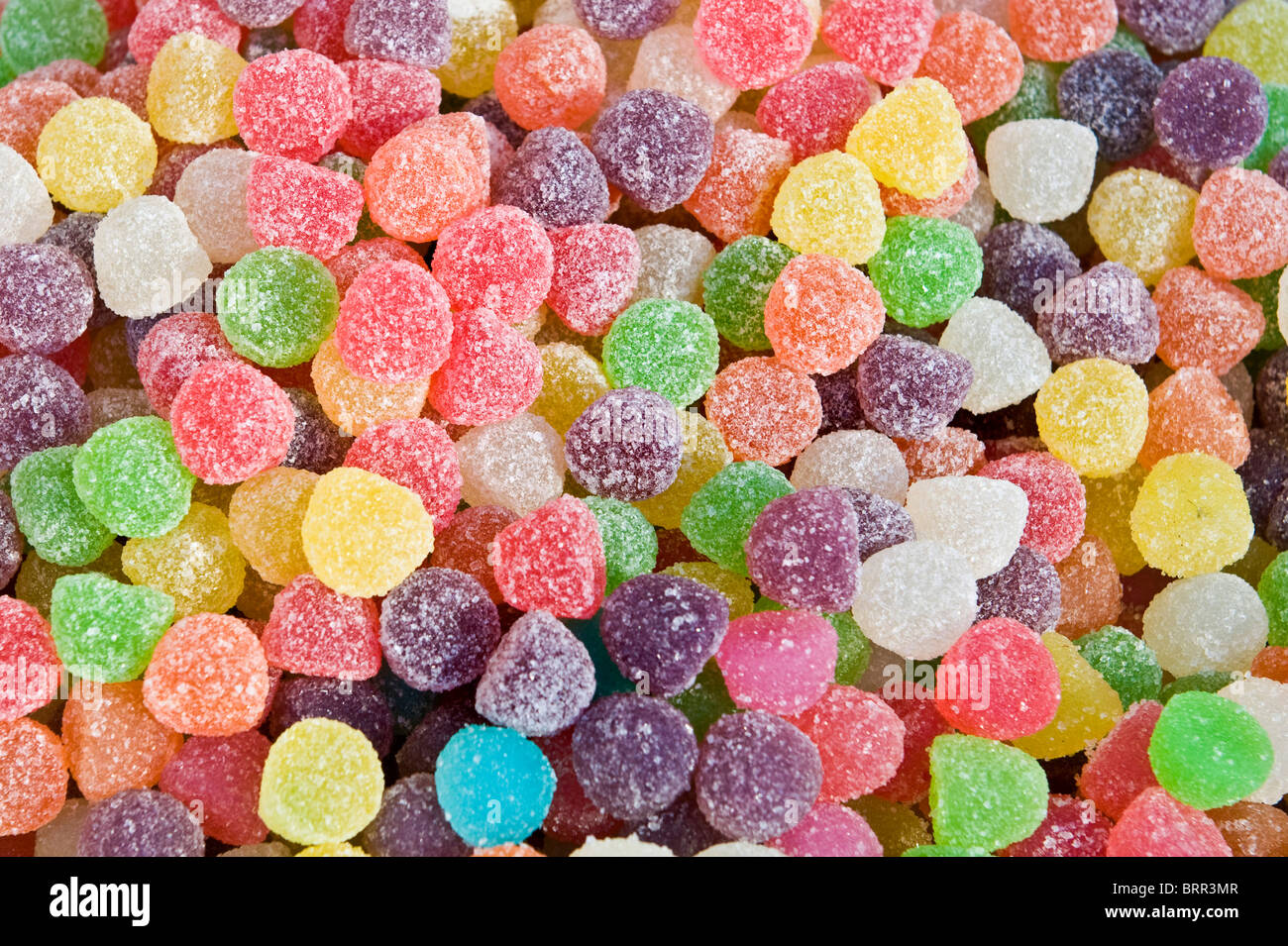 Close-up of small multicoloured sugar coated jelly candies - Stock Image
