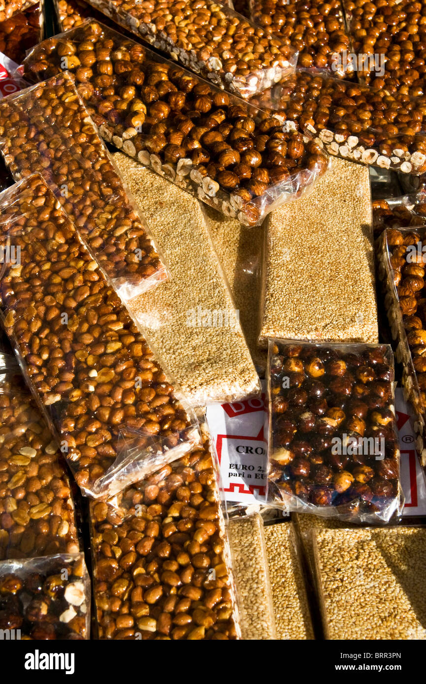 Close-up peanut, hazelnut and sesame seed brittle slices - Stock Image