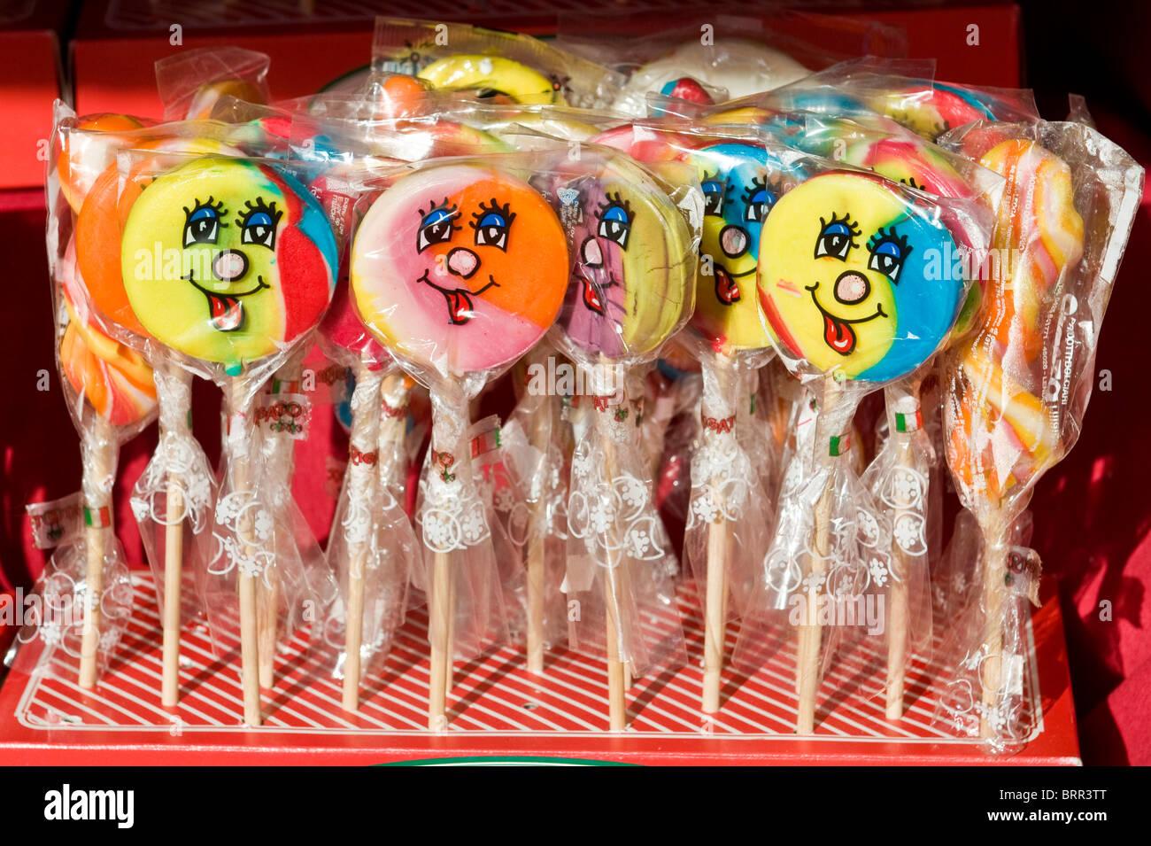 Close-up of multicoloured lollipops in  ellophane wrap - Stock Image