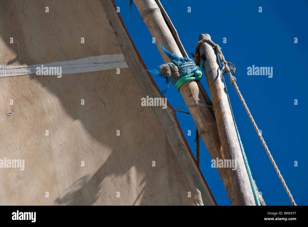 Close-up view of the mast and canvas sail of a dhow or traditional fishing boat - Stock Image
