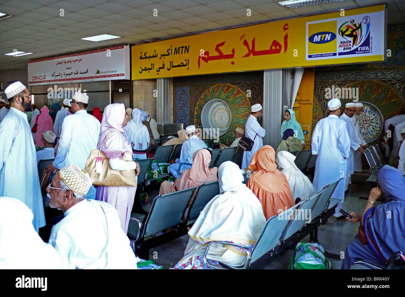 Passengers waiting in departure lounge at Sana'a airport Stock Photo