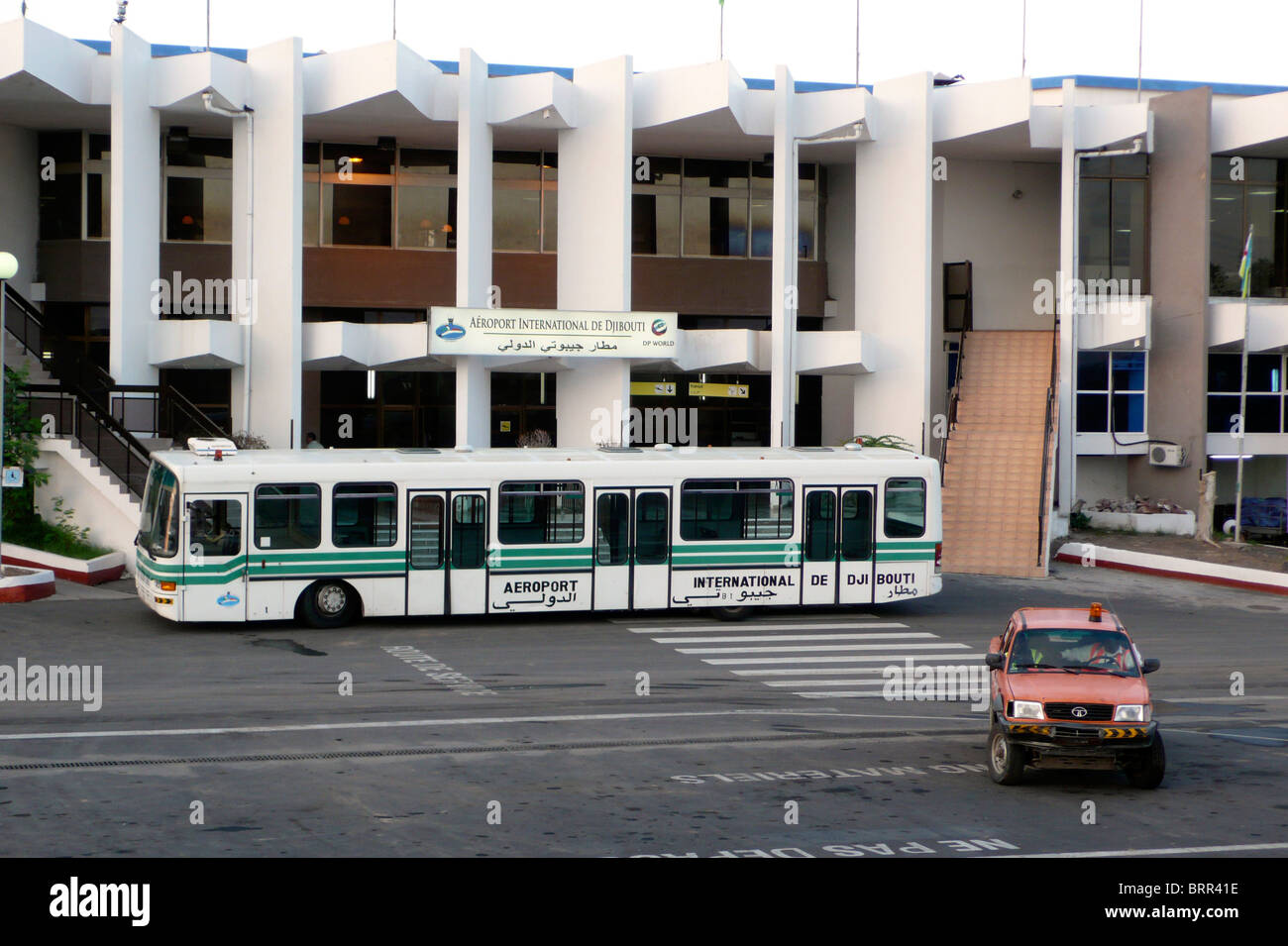 Bus parked outside Djibouti airport - Stock Image