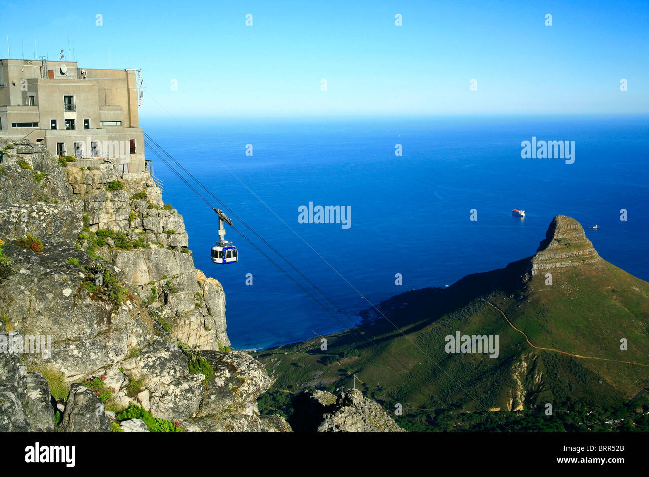 Table Mountain cableway, with Atlantic Ocean and Lions Head in background - Stock Image