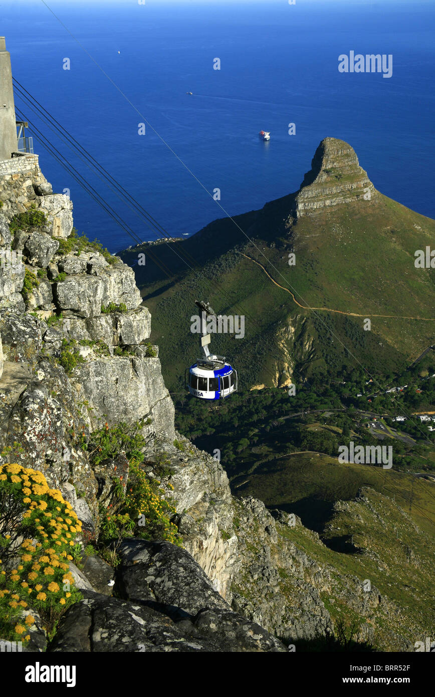 Table Mountain cableway with Lions Head and Atlantic Ocean in the back - Stock Image