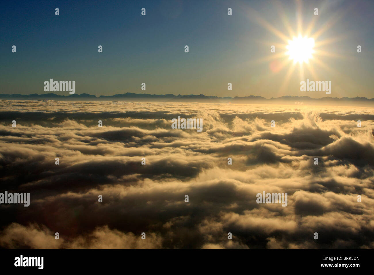 Sunrise above the clouds - Stock Image