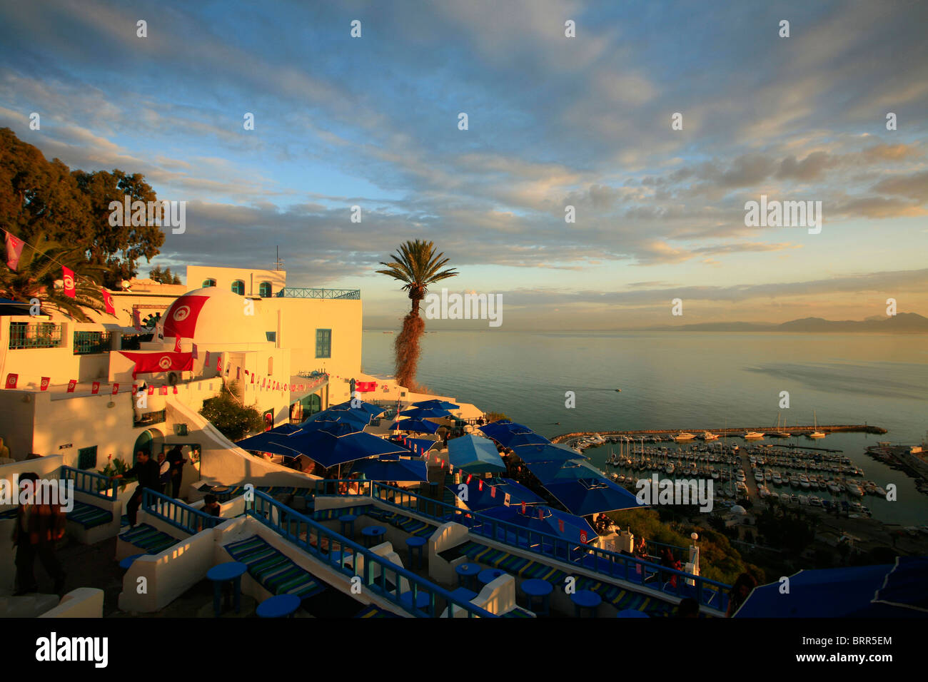 Sunset at a cafe in the upmarket suburb of Sidi Bou Said, a cliff top village popular with tourists near the capital - Stock Image