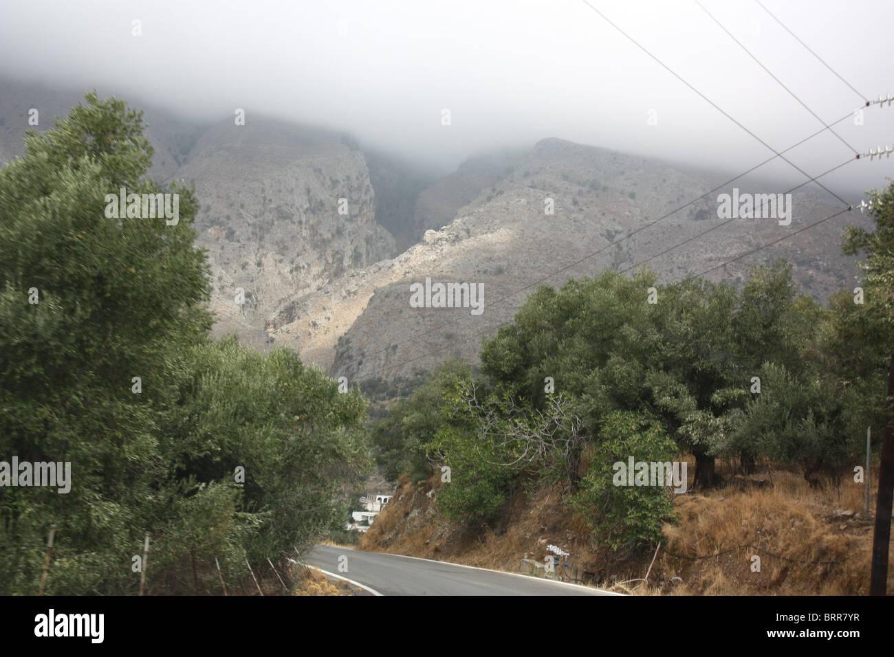 Rain cloud on mountain, September 2010, mountain road to Rodakino - Stock Image