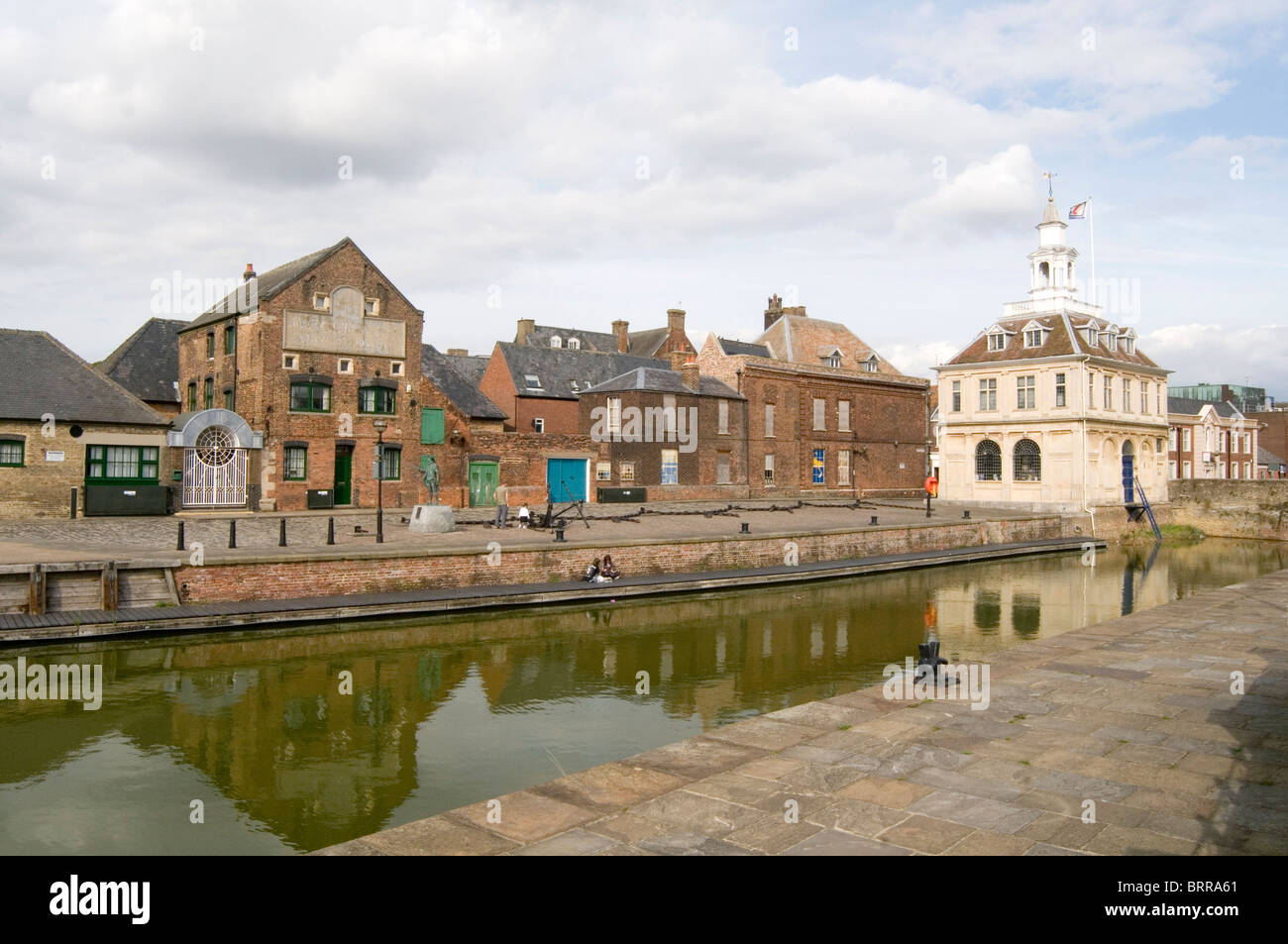 kings lynn great ouse river side warehouses warehouse quayside quay canal water norfolk dock docks - Stock Image