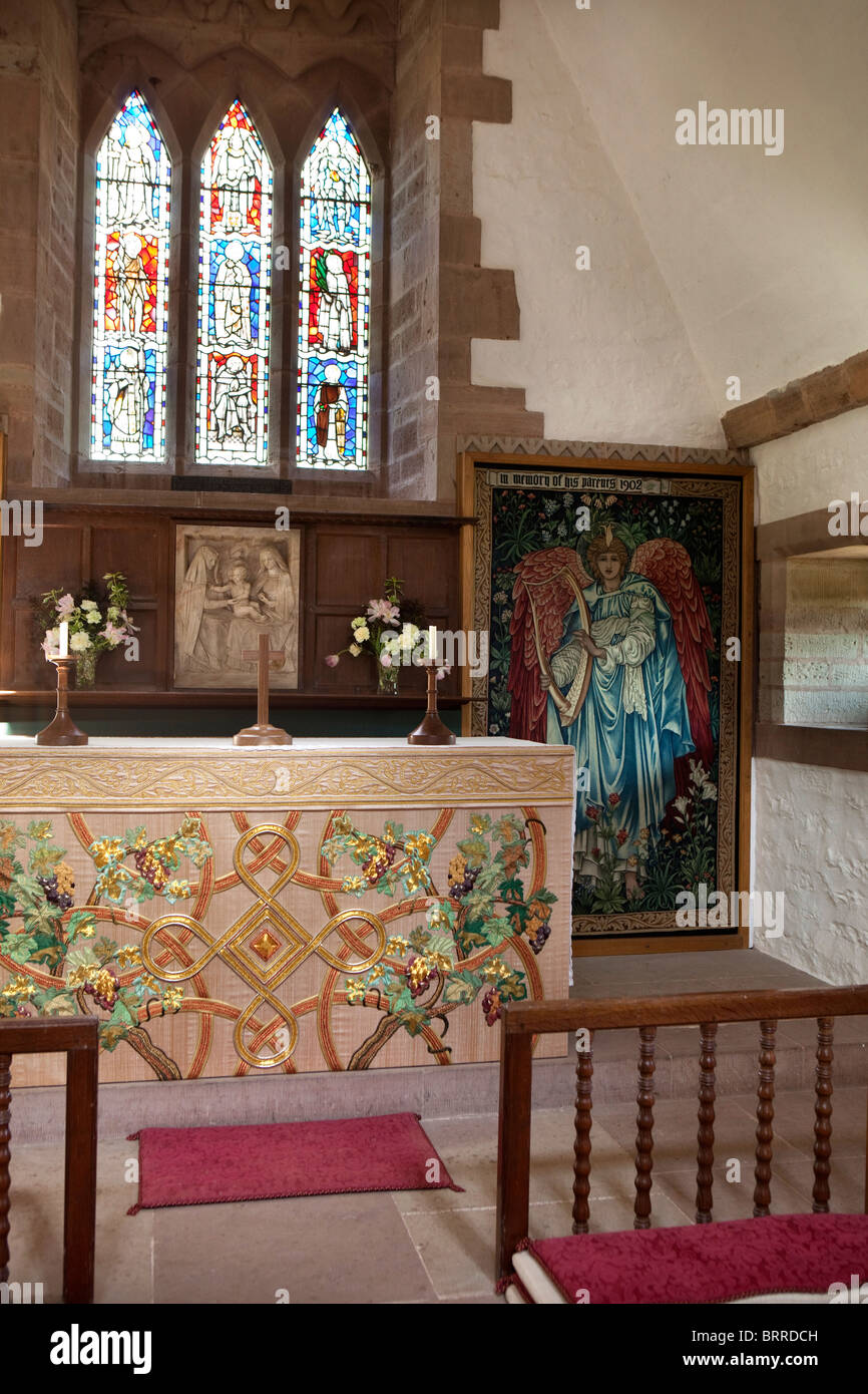 UK, Herefordshire, Brockhampton, All Saints Arts and Crafts Church, altar with Edward Burne Jones textiles Stock Photo