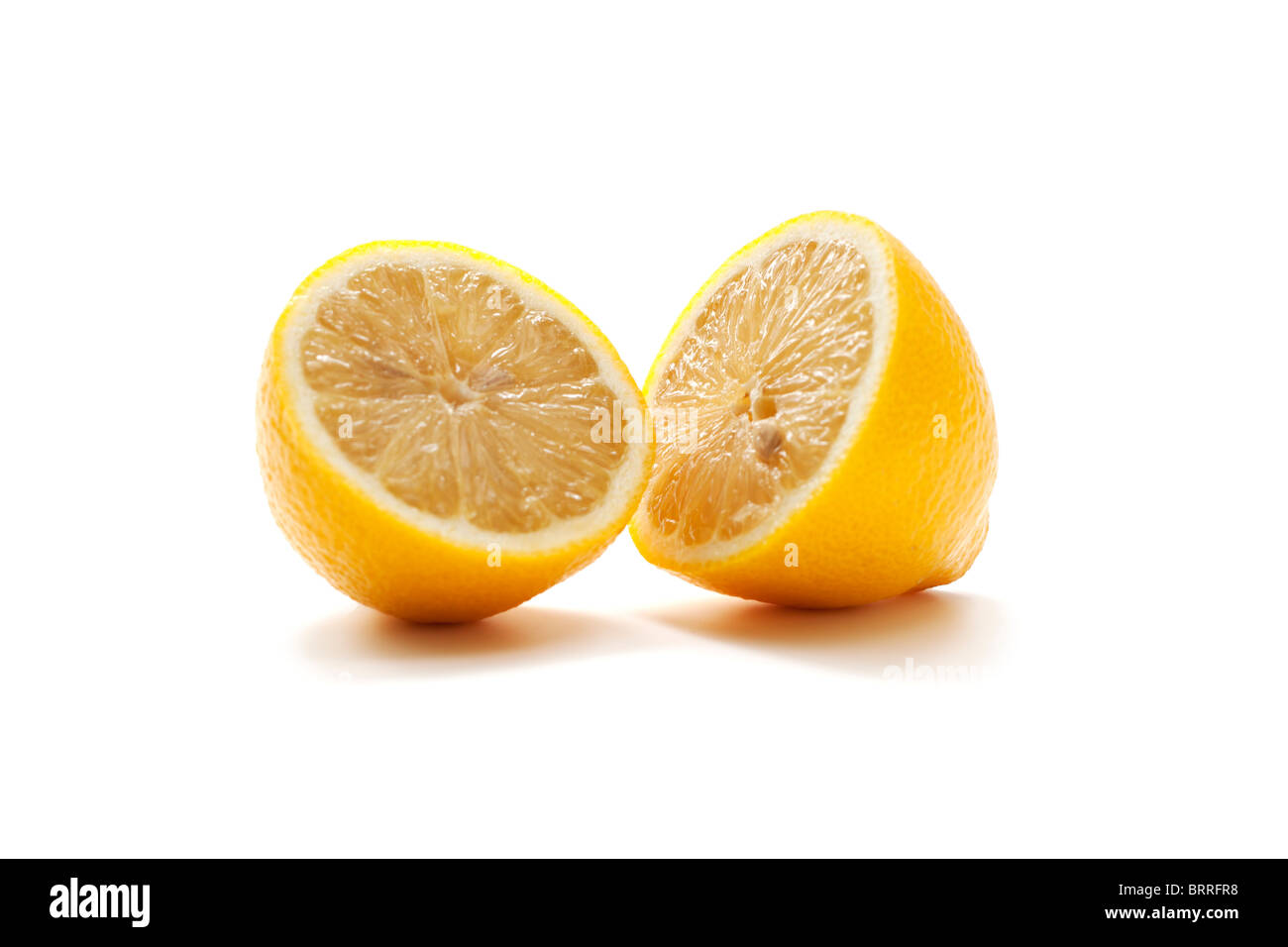 Fresh lemon cut in half Stock Photo