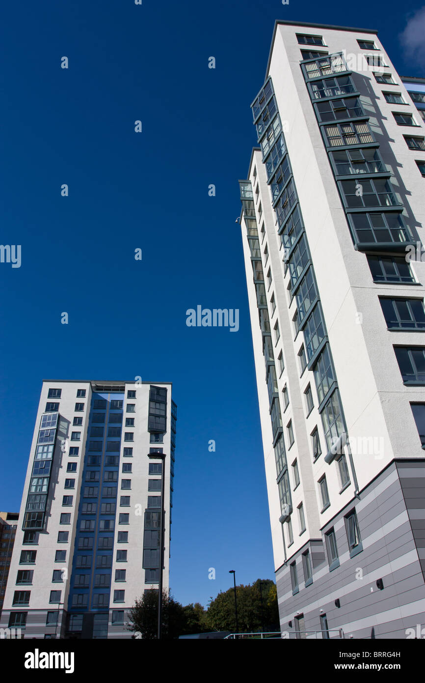 Abstract Architecture of hi rise tower block against vivid blue sky with converging verticals to emphasise or emphasize - Stock Image