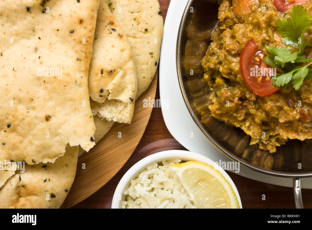 Indian curry meal of spicy chicken rice and naan bread stock photo indian curry meal of spicy chicken rice and naan bread forumfinder Gallery