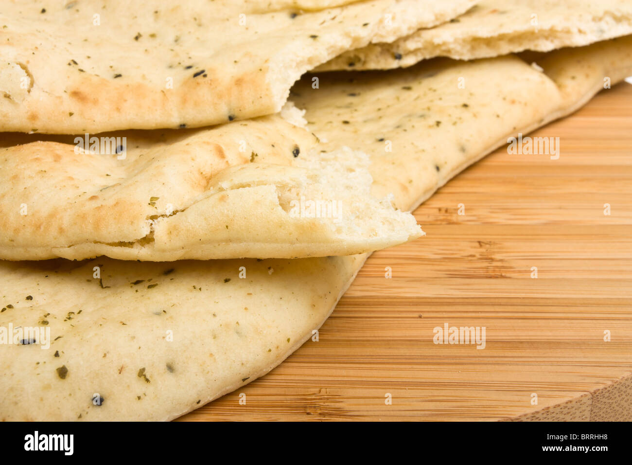 Indian unleavened bread side dish known as Naan Bread usually served with curry. - Stock Image