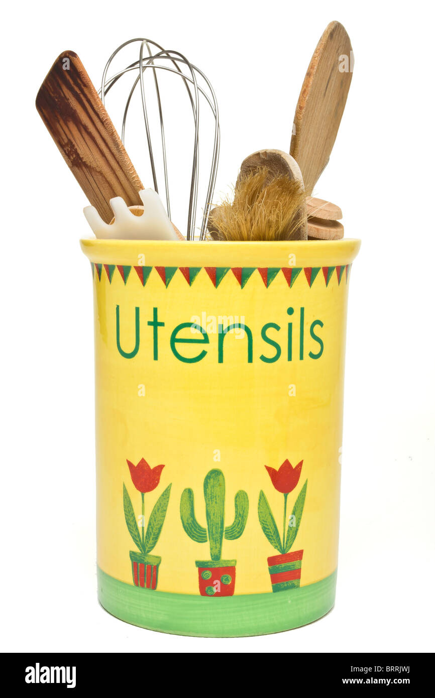 A selection of Kitchen Utensils in ceramic pot isolated on white. - Stock Image