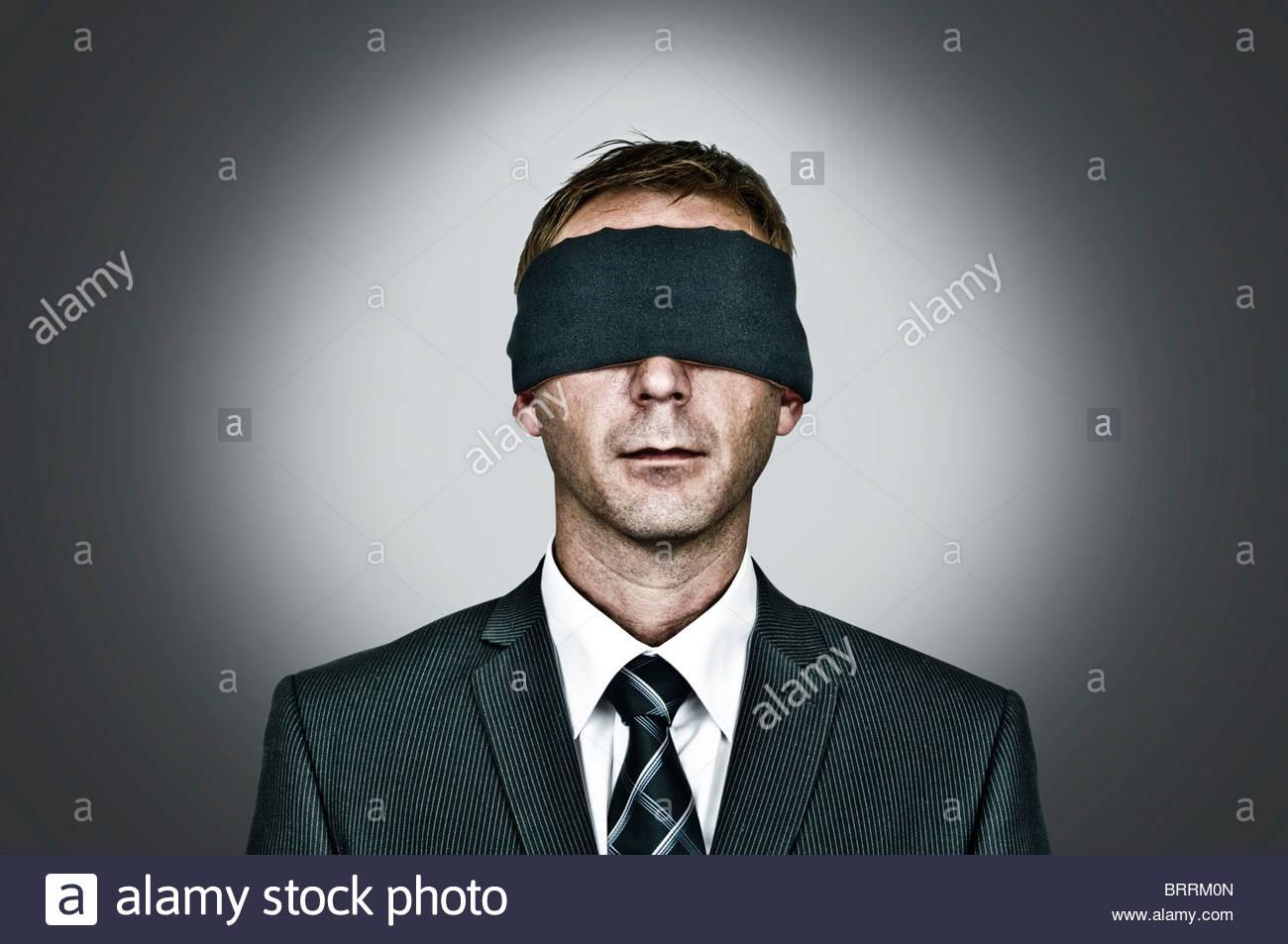 Man blindfolded - Stock Image