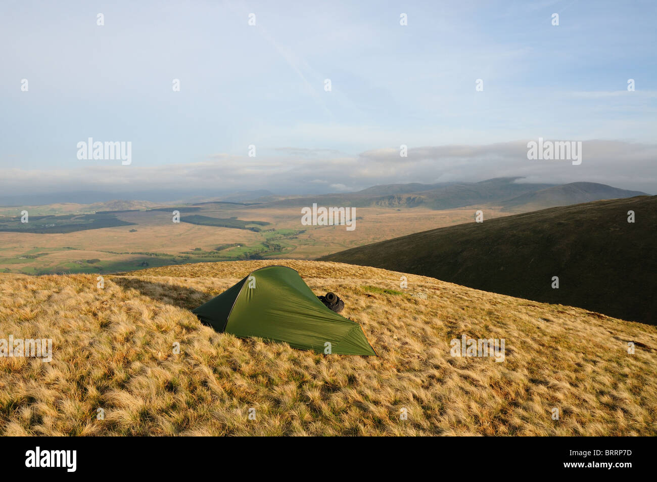 Wild camping on White Horse Bent below Bannerdale Crags in the English Lake District - Stock Image
