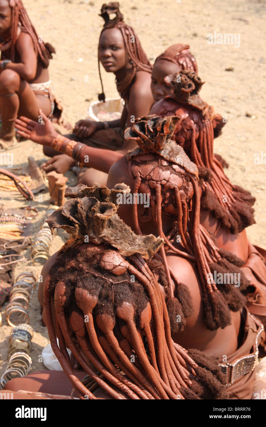 Himba people in the remote Opuwo region of Namibia - Stock Image