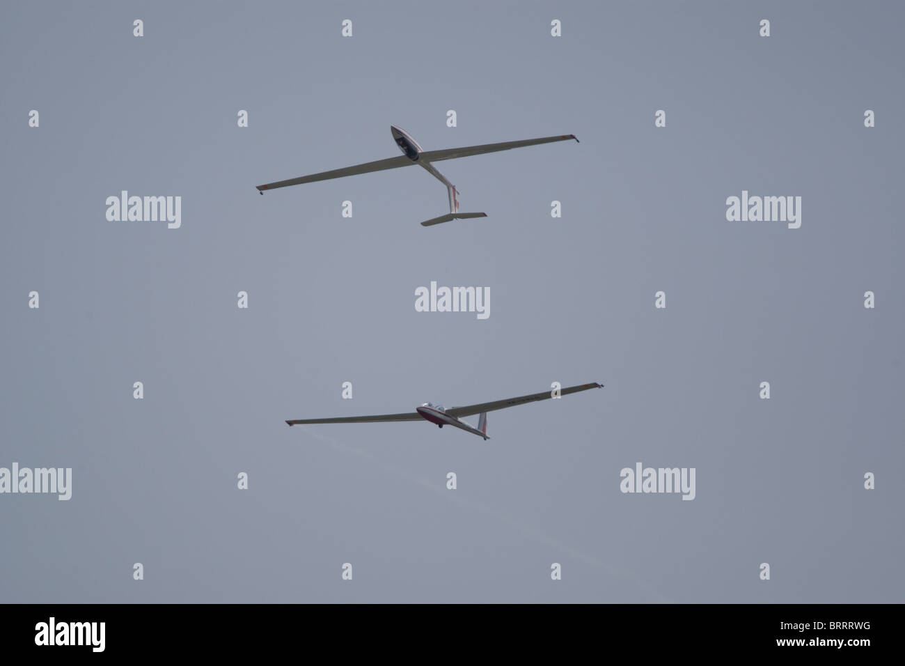 glider sailplane airplane airshow aircraft gliding sky blue stock