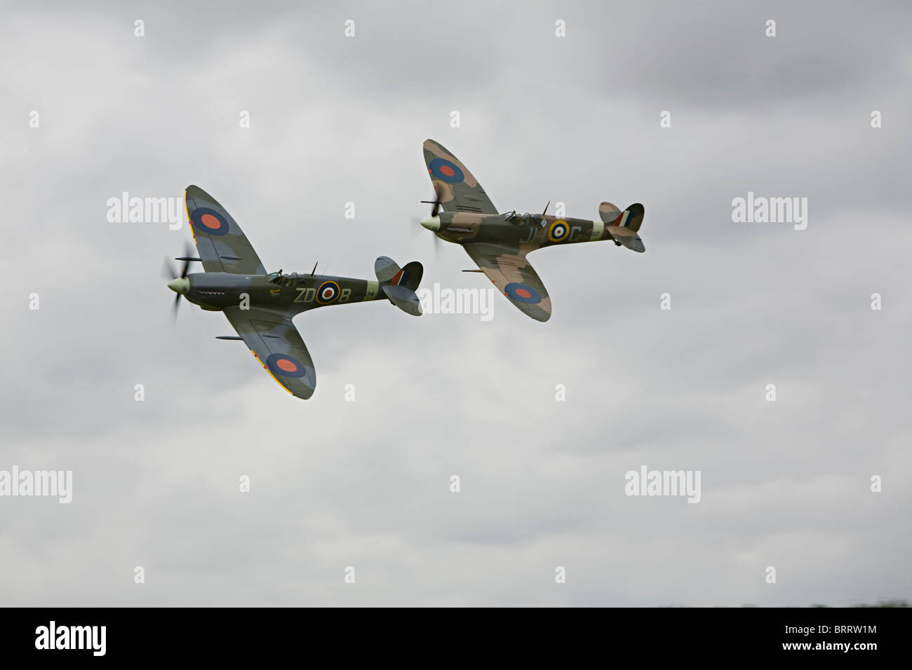 Spitfire and Hurricane flying at Goodwood Revival, Chichester, West Sussex - Stock Image