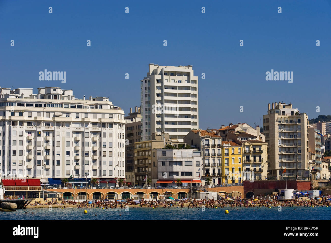 Beach in front of multistory buildings in Marseille, Provence Cote d' Azur, France - Stock Image