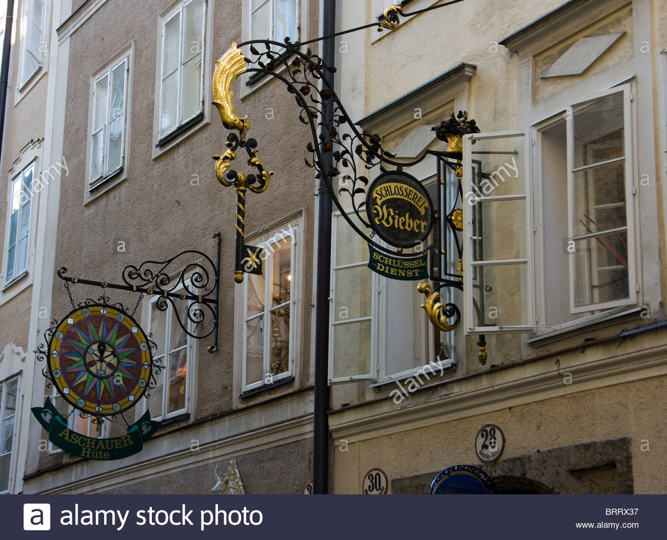 Austria Salzburg Ornate Shop Signs Locksmith - Stock Image