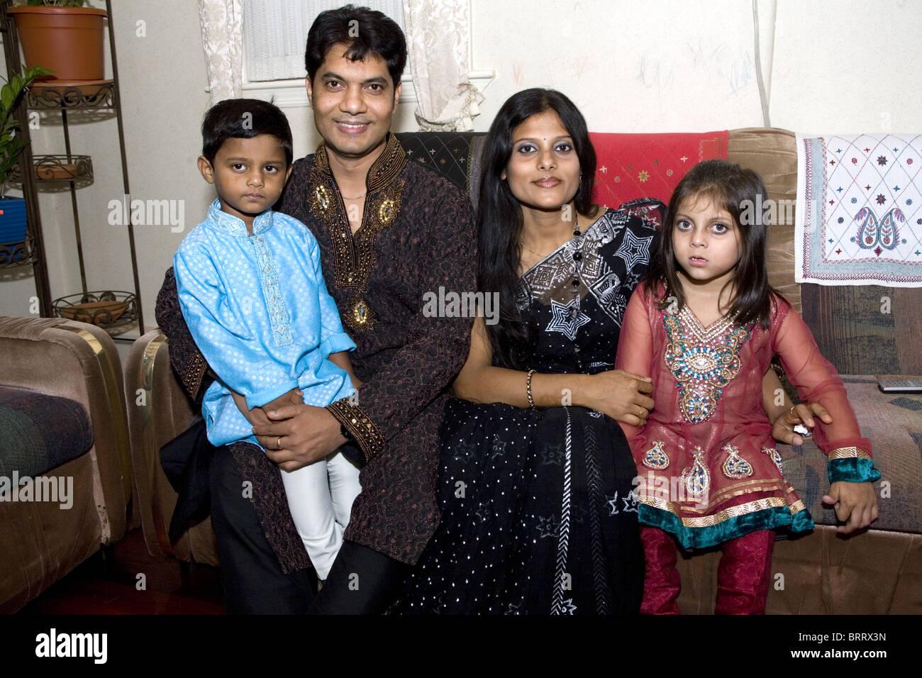 Bangladeshi American Muslim family on the holiday Eid marking the end of Ramadan in Brooklyn, New York. Portrait - Stock Image