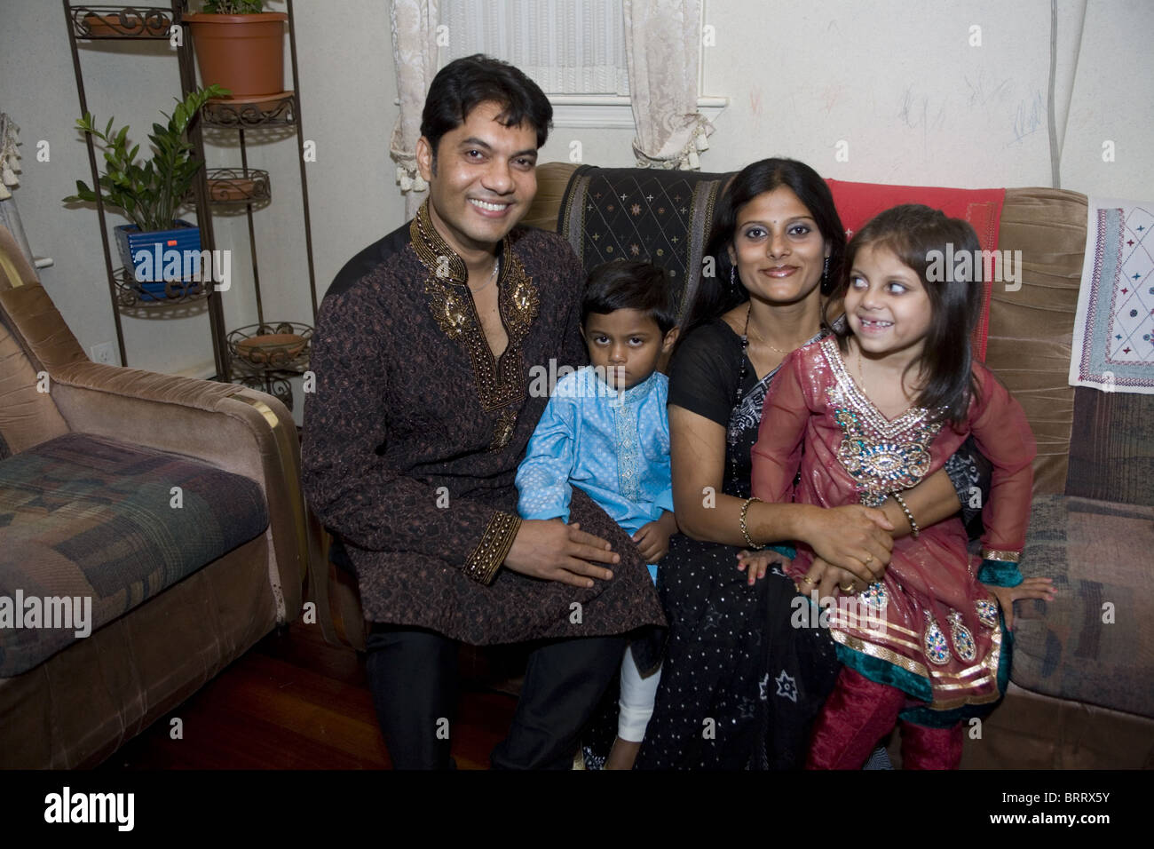 Bangladeshi American Muslim family on the holiday Eid marking the end of Ramadan in Brooklyn, New York. - Stock Image