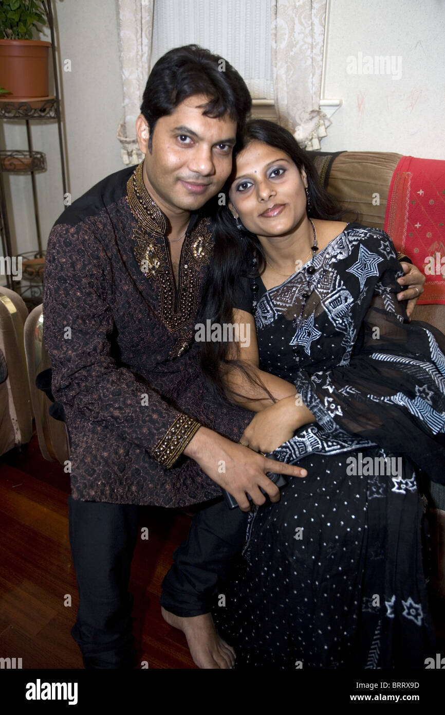 Bangladeshi Muslim couple on the holiday of Eid in Brooklyn, New York. Portrait at home - Stock Image