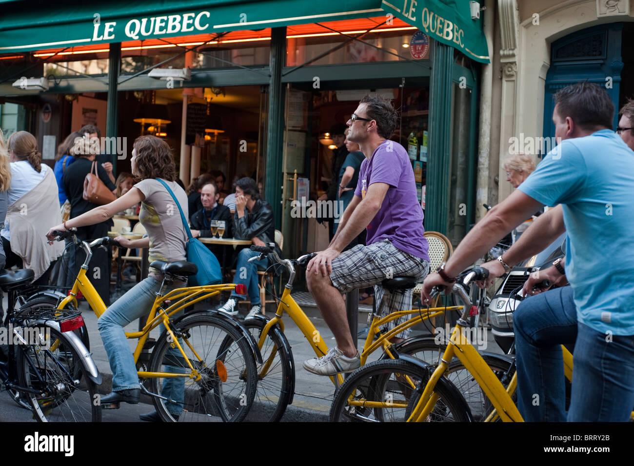Paris, France, Adult Tourists Visiting Paris by Bicycle Tour, bicycling, Saint Germain des Pres District Stock Photo