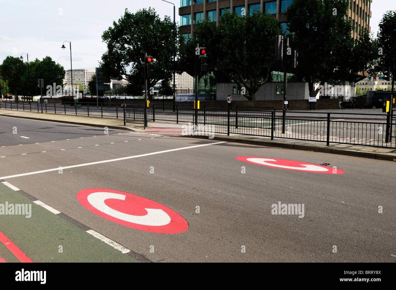 Red Congestion Charging Symbols painted on the Road, Millbank, London, England, UK, - Stock Image