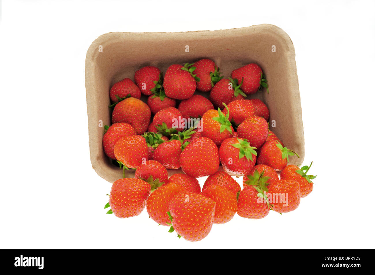 High key image of strawberries falling out of a punnet - Stock Image