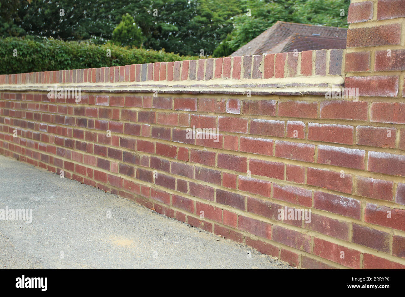 Newly constructed brick wall at the front of a house. - Stock Image