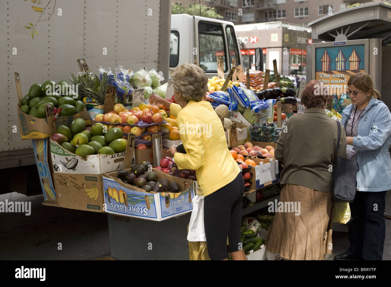 Neighborhood fruitstand amidst the fumes and congestion on Lexington Avenue in New York City. Stock Photo