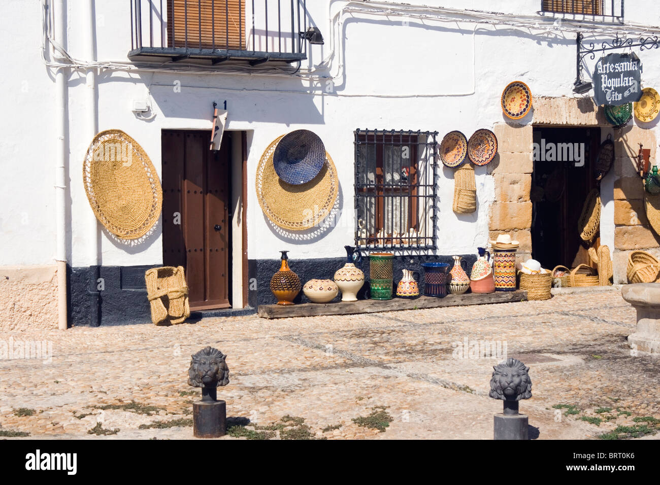 Ubeda, Jaen Province, Spain. Baskets and pottery outside souvenir shop. - Stock Image