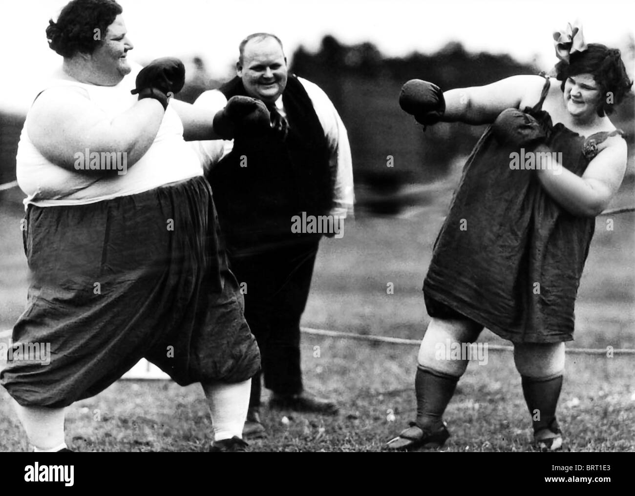 fat women boxing, historic photograph, around 1910 stock photo