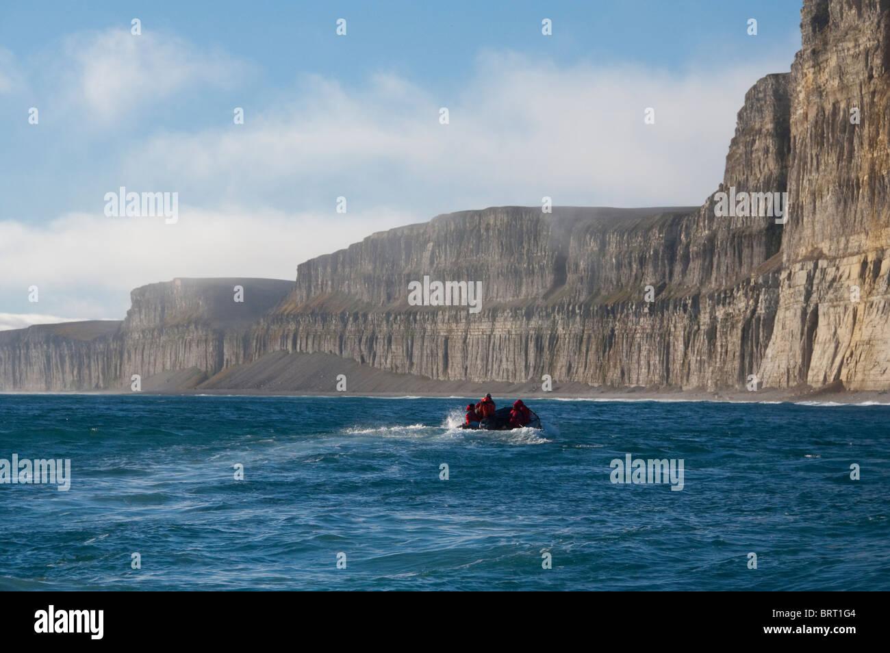 Canada, Nunavut, Qikiqtaaluk Region, Akpatok Island. Tourists in zodiac. - Stock Image