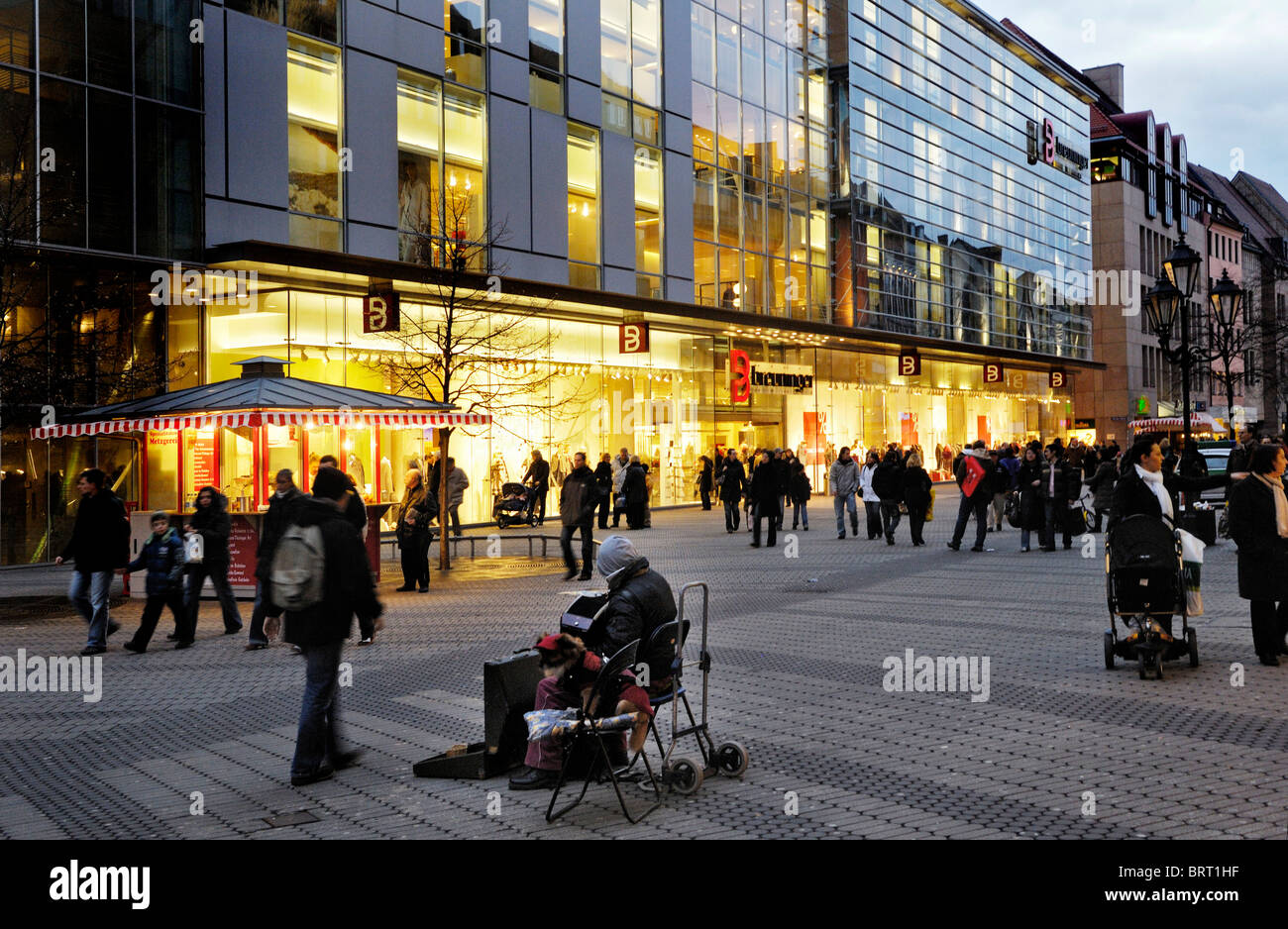 Beggar in front of a store, pedestrian area, Nuremberg, Bavaria, Germany, Europe - Stock Image