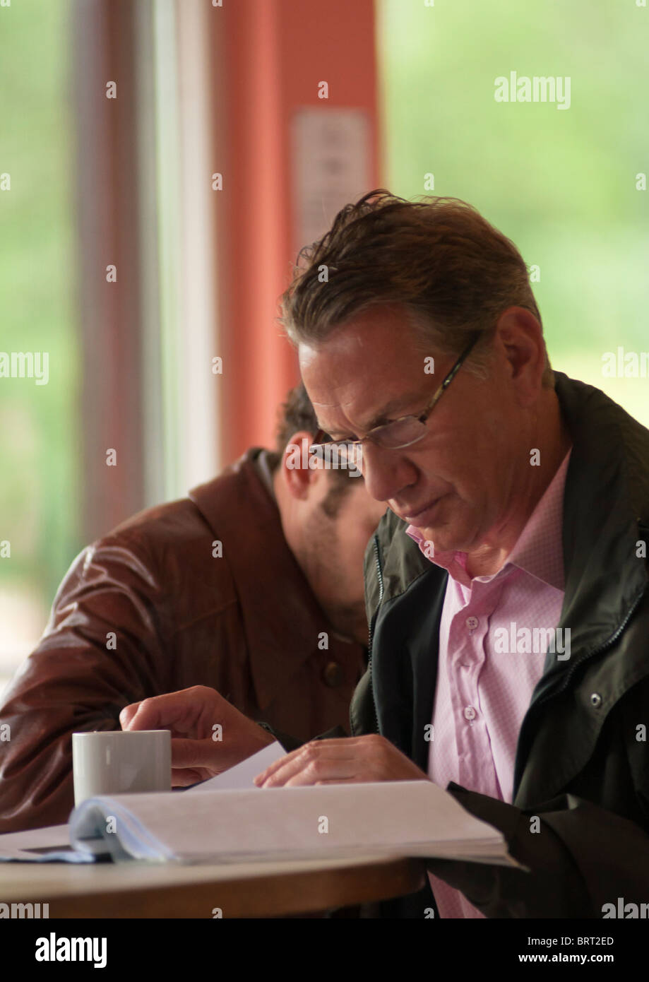 Michael Portillo, Conservative politician and TV personality, relaxing with a cup of coffee. - Stock Image