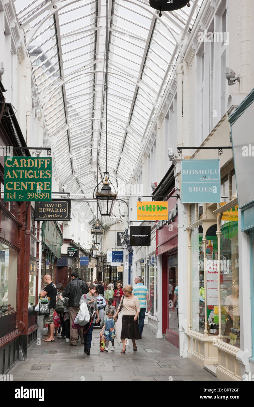 Shoppers in glass covered Victorian shopping precinct. Royal Arcade, Cardiff (Caerdydd), Glamorgan, South Wales, - Stock Image