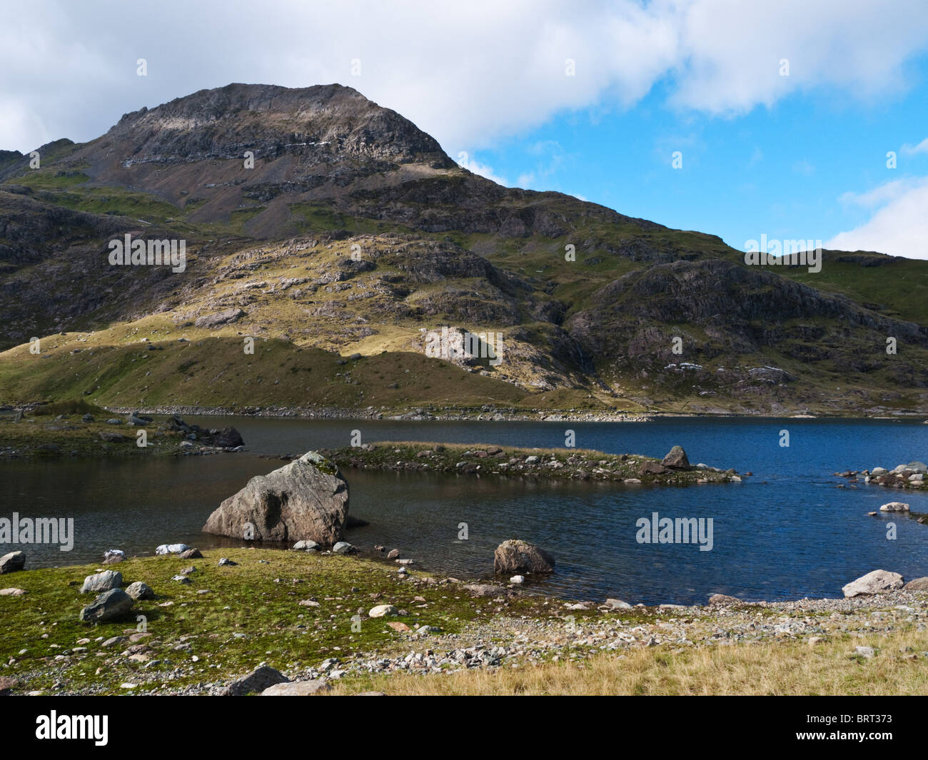 The peak of Crib Goch seen across Llyn Llydaw in Cwm Dyli, Snowdon - Stock Image