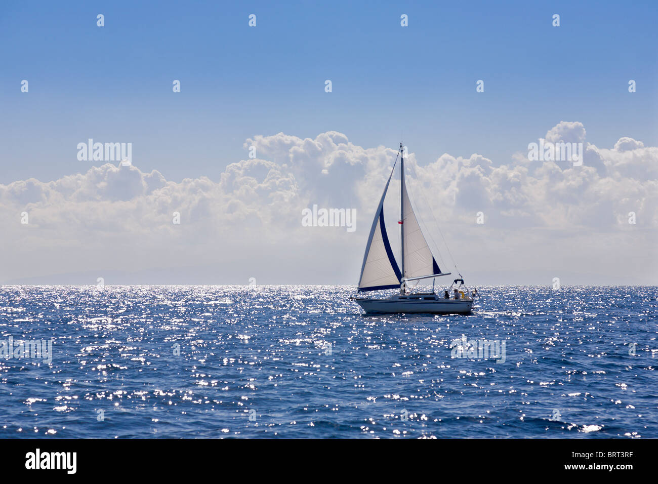 Yacht sailing on port tack, off Paxos, Greece Stock Photo