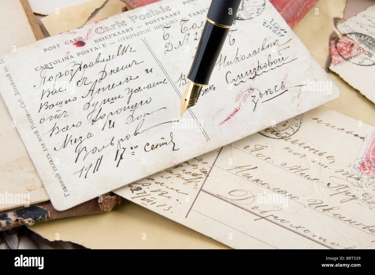 Retro postcards and gold pen - Stock Image