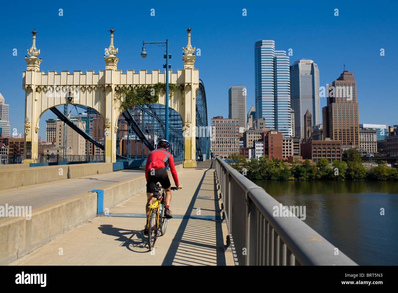 Biker crossing Smithfield Street Bridge over Monongahela River, Pittsburgh, Pennsylvania - Stock Image