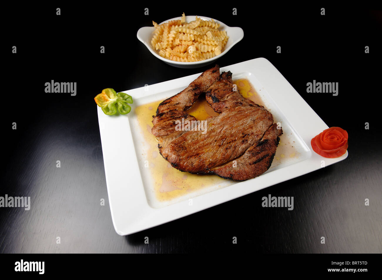 Grilled steak with french fries - Stock Image
