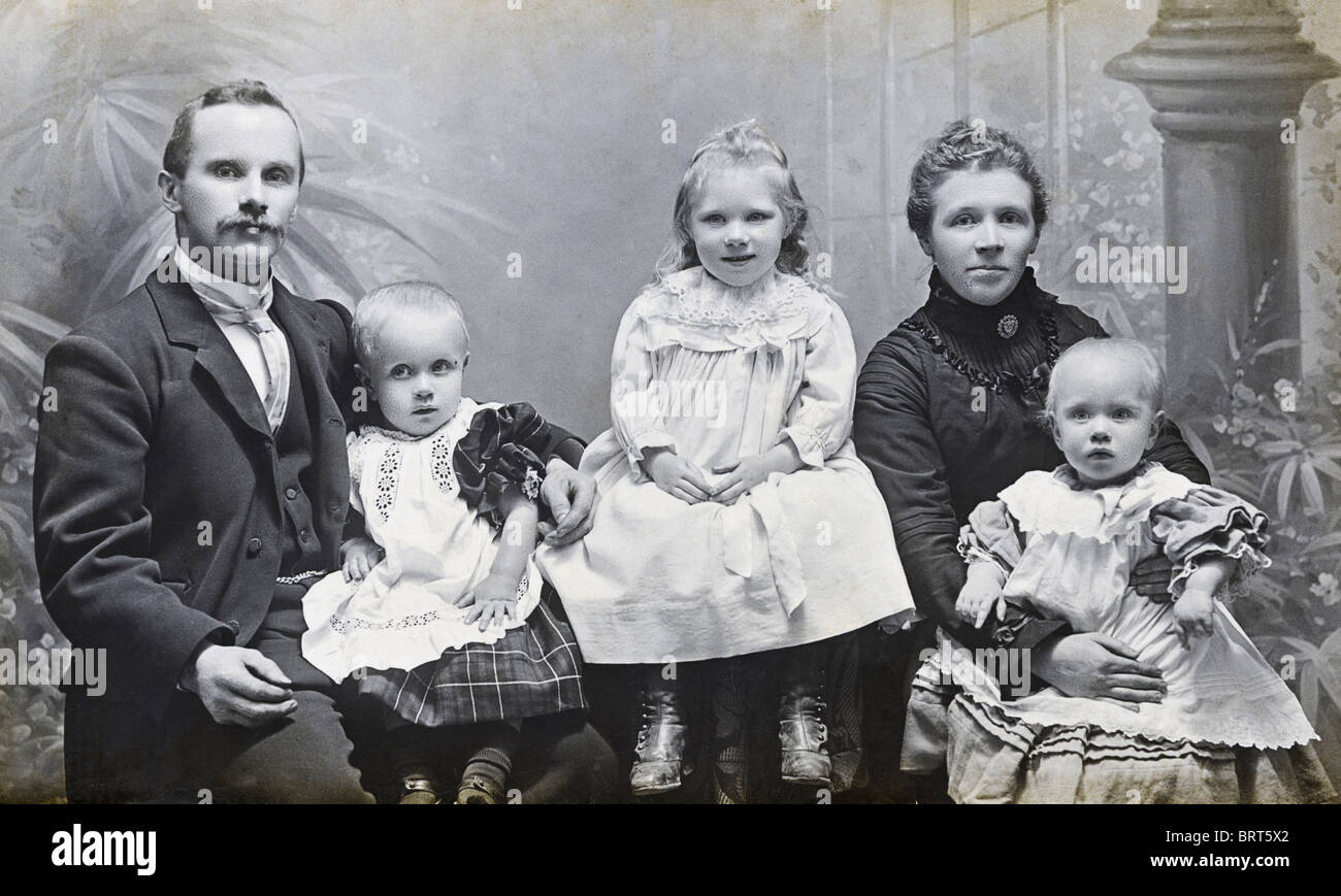 Victorian family studio portrait of father mother son and two daughters circa 1898 - Stock Image