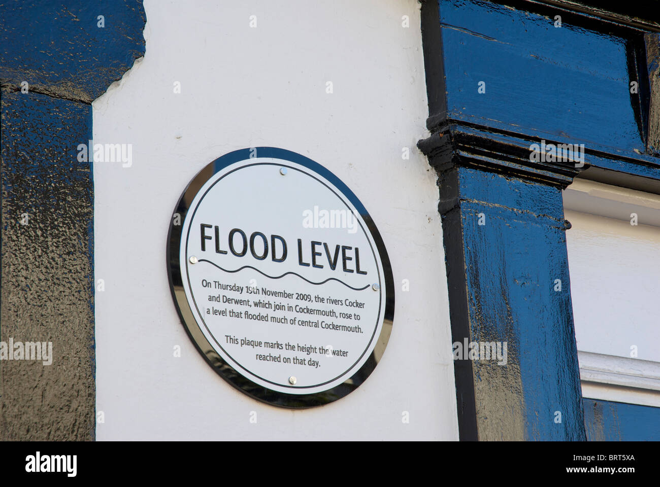 Plaque showing the height of the floodwaters, in November 2009, Cockermouth, West Cumbria, England UK - Stock Image